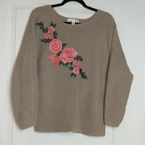Say what? Brown sweater with floral embellishment